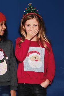 dziewczynka w swetrze z kolekcji świątecznej next